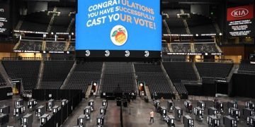 epaselect epa08739286 State Farm Arena is used as a polling place on the first day of early voting in the US Presidential election, shown underway in Atlanta, Georgia, USA, 12 October 2020.  EPA/JOHN AMIS