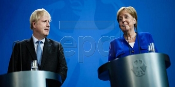 epa07784831 British Prime Minister Boris Johnson (L) and German Chancellor Angela Merkel give a joint press statement at the Chancellery in Berlin, Germany, 21 August 2019. Prior to the G7 summit in Biarritz form 24 to 27 August 2019, Johnson meets Angela Merkel and on the next day French President Emmanuel Macron. In the talks, Johnson is expected to try to resume the Brexit talks, so that it will not come to a 'no deal' exit of the United Kingdom from the EU on 31 October 2019.  EPA-EFE/CLEMENS BILAN