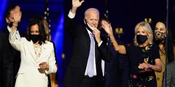 epa08806608 President-elect Joe Biden (C) and Dr. Jill Biden (R) with Vice President-elect Kamala Harris (L) are joined by family members after Biden delivered his victory address after being declared the winner in the 2020 presidential election in Wilmington, Delaware, USA, 07 November 2020. Biden defeated incumbent US President Donald J. Trump.  EPA-EFE/JIM LO SCALZO