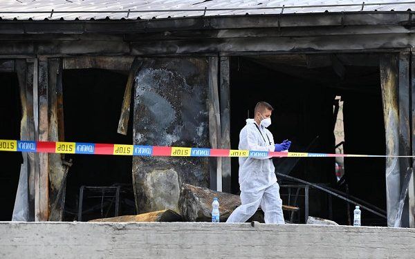 epa09456810 Investigators at the scene following a fire at a hospital for Covid-19 patients in Tetovo, Republic of North Macedonia, 09 September 2021. At least fourteen deaths have been reported by the Ministry of Health when a fire, thought to have been triggered by oxygen cylinders that provide oxygen to patients with a more severe clinical case of Covid-19, broke out at the hospital.  EPA-EFE/Georgi Licovski