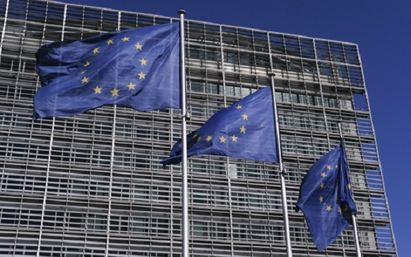 epa06615769 European flags in front of European commission headquarters , also called Berlaymont Building reflected in European council building in Brussels, Belgium, 20 March 2018.  EPA-EFE/OLIVIER HOSLET