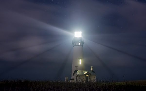 Low angle view of illuminated Yaquina Head Light against sky at night  Image downloaded by Charlie Brewer at 15:04 on the 28/05/19
