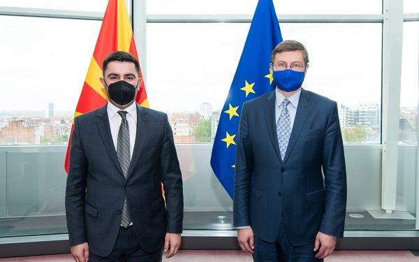 From left to right, Kreshnik Bekteshi, Valdis Dombrovskis
