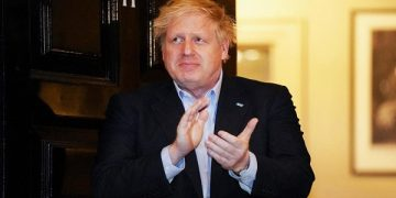 epa08344738 (FILE) A handout photo made available by No. 10 Downing Street of Britain's Prime Minister Boris Johnson applauding during a 'Claps for our Carers' outside 11 Downing Street in London, Britain, 02 April March 2020 (re-issued 05 April 2020). According to reports on 05 April 2020, British Prime Minister Boris Johnson was admitted to hospital ten days after being tested positive for coronavirus Covid-19.  EPA-EFE/PIPPA FOWLES / DOWNING STREET  HANDOUT EDITORIAL USE ONLY/NO SALES