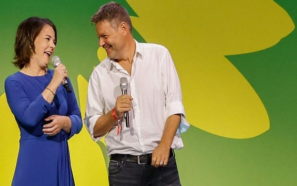 The co-leader of Germany's Green party and the party's candidate for chancellor, Annalena Baerbock, and co-leader Robert Habeck speak at their electoral party. Photograph: David Gannon/AFP/Getty Images