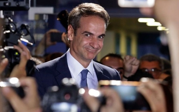 ATHENS, GREECE - JULY 07: Greek opposition New Democracy conservative party leader Kyriakos Mitsotakis waves to his supporters after winning the parliamentary elections at the New Democracy headquarters on July 7, 2019 in Athens, Greece. Prime Minister Alexis Tsipras's Syriza party have conceded defeat in the country's general election.  (Photo by Milos Bicanski/Getty Images)