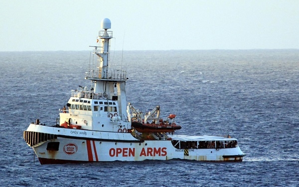 epaselect epa07774325 A view of Spanish humanitarian ship Open Arms, with 147 migrants on board, in the immediate vicinity of Lampedusa, southern Italy, 15 August 2019. Several patrol boats of the Italian finance guard and the harbor master's office are monitoring the movements of the Spanish NGO boat that headed towards the island of Pelagie, escorted by two military ships, after the Lazio Regional Administrative Court accepted its appeal, suspending the ban on entry into Italian waters ordered by Italian Interior Minister Matteo Salvini.  EPA-EFE/ELIO DESIDERIO
