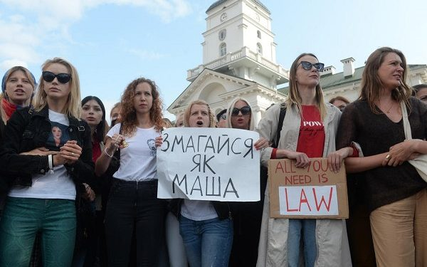 epa08664747 Belarusian women protest against the presidential election results during women's peaceful solidarity action in Minsk, Belarus, 12 September 2020. Opposition activists continue their every day protest actions, demanding new elections under international observation. A poster reads: ?Fight like Masha?.  EPA-EFE/STRINGER