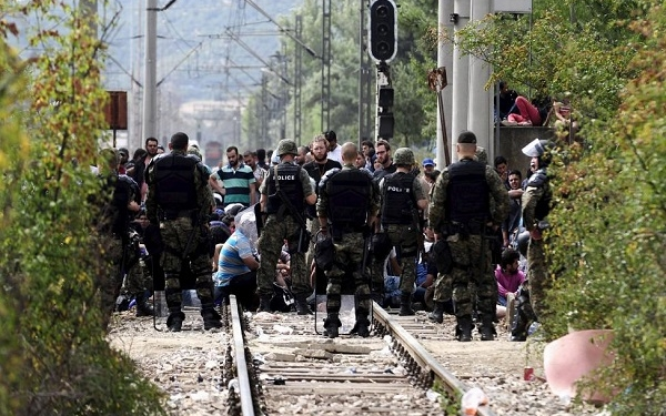 Macedonian special policemen guard the border as more than a thousand immigrants wait at the border line of Macedonia and Greece to enter Macedonia near the Gevgelija railway station August 21, 2015.  REUTERS/Ognen Teofilovski