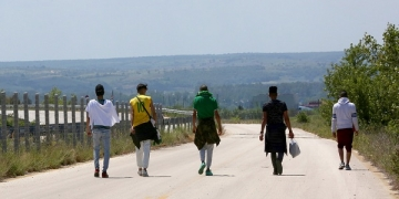 epaselect epa06744391 Migrants that identified themselves as Palestinians, walk near Orestiada city, some eight hundred meters from the Turkish border, after crossing illegally Evros River to enter in Greece, 11 May 2018 (issued 17 May 2018). Refugees remain detained in the camp until their identification is completed, approximately 20 days, and then they are going to be transferred to hot spots all over Greece.  As opposed to April when migrant inflows were too high (3,627), May shows a decrease of migrants (808) arriving in Greek mainland crossing the river Evros.  EPA-EFE/ORESTIS PANAGIOTOU