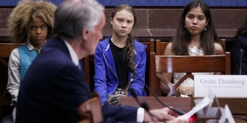 epa07848948 Greta Thunberg (2-L), the 16 year old climate change activist from Sweden, attends a Senate Climate Change Task Force meeting in the US Capitol in Washington, DC, USA, 17 September 2019. The meeting is part of a week of activities culminating in a climate strike on Friday, 20 September, in which workers and students around the world will walk out to demand more action to fight global warming.  EPA-EFE/SHAWN THEW