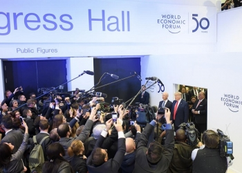 epa08146929 US President Donald J. Trump (R, red tie) speaks to the media next to German Klaus Schwab (2-R), Founder and Executive Chairman of the World Economic Forum, before addressing a plenary session during the 50th annual meeting of the World Economic Forum (WEF) in Davos, Switzerland, 21 January 2020. The meeting brings together entrepreneurs, scientists, corporate and political leaders in Davos under the topic 'Stakeholders for a Cohesive and Sustainable World' from 21 to 24 January 2020.  EPA-EFE/ALESSANDRO DELLA VALLE