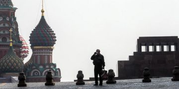epa08330022 A single man wearing protective mask stands in front of the cathedral of Vasily the Blessed and Lenin's mousaleum on the Red Square in Moscow, Russia, 29 March 2020. Russian authorities recommended for all Russians do not leave their homes for nine days in order to stop the spread of the coronavirus Covid-19 disease. The next week was declared not working for evrebody, all restaurants, bars, shopping centers, cinemas and city parks were closed. According to the Russian Quarantine Service of Rospotrebnadzor (Russian Federal Service for Surveillance on Consumer Rights Protection and Human Wellbeing), eight people died and 1534 cases of the Covid-19 disease have been confirmed in Russia.  EPA-EFE/SERGEI ILNITSKY