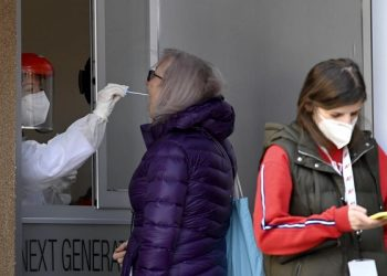 epa09046305 A medical worker wearing a personal protective equipment (PPE) collects nasopharyngeal swab samples to test for the SARS-CoV-2 coronavirus causing the COVID-19 disease, through the window of a private laboratory in Skopje, Republic of North Macedonia, 02 March 2021. The number of newly infected people with Coronavirus disease, COVID-19 rise again in North Macedonia. According to the Minister of health Venko Filipce, 70 per cent of newly infected people are with Britsish mutation of COVID-19. Apart from the Serbian donation of 8,000 vaccines, Northern Macedonia has still not been able to get any vaccine against Covid-19.  EPA-EFE/GEORGI LICOVSKI