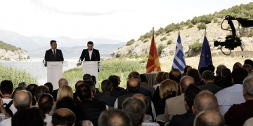 Signing ceremony of the agreement on the name issue between the Foreign Ministers of Greece and FYROM, in the border village of Psarades, Prespa lakes, Greece on June 17, 2018. The Foreign Ministers of Greece, Nikos Kotzias and his FYROM counterpart, Nikola Dimitrov, sign an agreement to change the name of the FYROM to the 'Republic of North Macedonia', in the presence of the Prime Ministers of the two countries, Alexis Tsipras and Zoran Zaev. / Τελετή υπογραφής της συμφωνίας για το θέμα του ονόματος μεταξύ των Υπουργών Εξωτερικών της Ελλάδας και της ΠΓΔΜ, στο χωριό Ψαράδες, Λίμνες Πρέσπες, Ελλάδα στις 17 Ιουνίου 2018. Οι Υπουργοί Εξωτερικών Ελλάδας, Νίκος Κοτζιάς και ΠΓΔΜ, Νίκολα Ντιμιτρόφ, υπογράφουν την συμφωνία για την αλλαγή του ονόματος της ΠΓΔΜ σε 'Βόρεια Μακεδονία', παρουσία των Πρωθυπουργών των δύο χωρών, Αλέξη Τσίπρα και Ζόραν Ζάεφ.